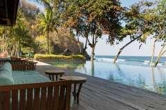 Perfectly positioned along an uninterrupted stretch of curving beach,
