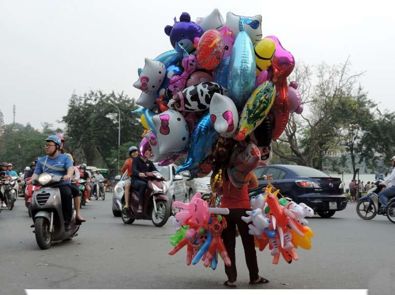 And balloon-selling hawkers appeared as colorful islands in