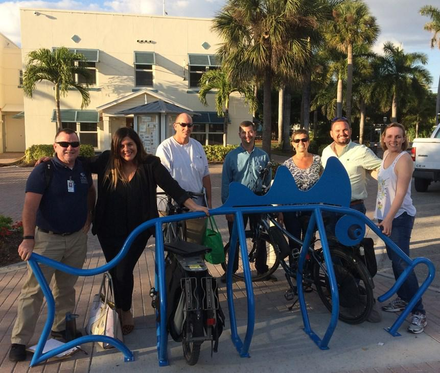 The Bicycle Pedestrian Committee standing near a fish inspired bike rack that has been installed near the Liles Hotel in downtown Bonita Springs City of Bonita Springs to Participate in the Lake