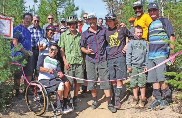The ribbon was cut by Tara Llanes, who is leading the way for adaptive mountain biking in BC.