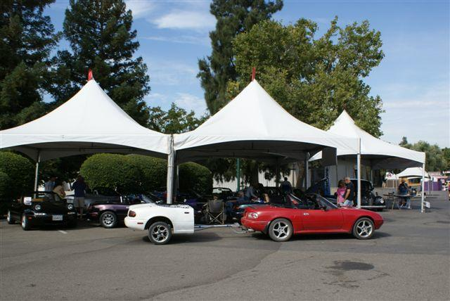 After arriving at Mimi s Café the meeting location, the group of 13 Miatas and 1 Corba drove to the State Fair set- up area located near the horse racing grandstand.