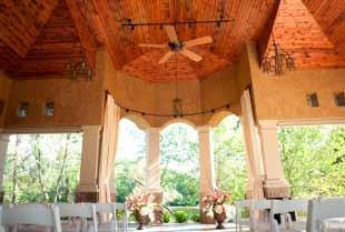 The Pavilion Venue Details Stucco and Stone Exterior combined with Beautiful Wood Ceilings and Wrought-Iron Details Cream colored curtains