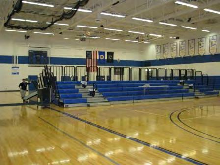 Bleacher seating with a capacity of 2,200 and 700 is in the respective gyms.