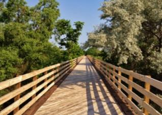 The 6K loop is an out and back on the Dark Island Trail. You should reach the bridge just in time to see the sunset over the Platte River. The trail's unique name derives from a local Pawnee legend.