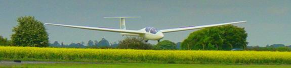 WHAT IS GLIDING? A glider is the same as a normal aeroplane except that it doesn t use an engine when it is in flight.