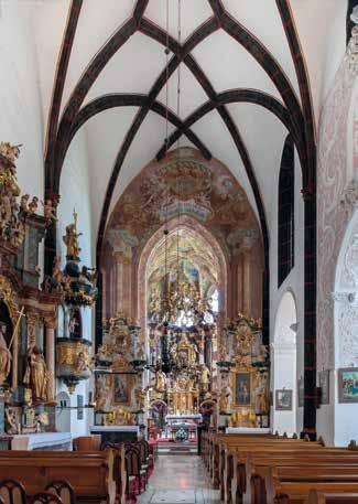 ) A southeast view of the church with gothic chancel and adjacent baroque chapels (photo: G.