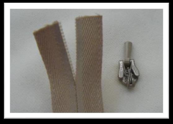To insert the zipper pull onto the invisible zipper chain, first separate about 1 ½ inches of the zipper teeth.