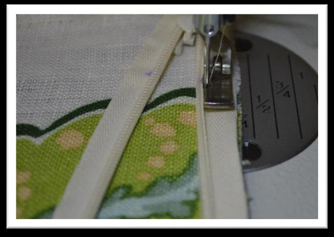 know everything is lining up correctly as you stitch. Open the zipper.