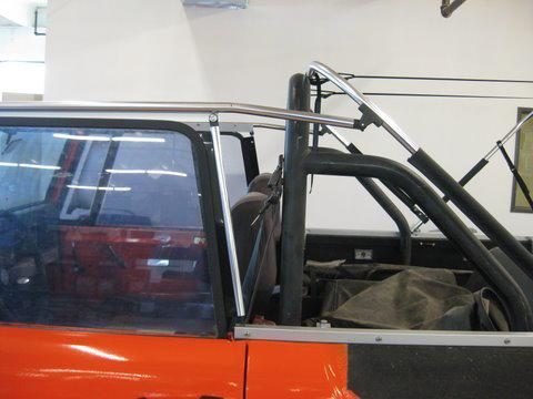 Step 8 Unfold the canopy and place it on top of the assembled frame structure and snap it to the windshield header. Now attach the rear snaps over and around the rear crossbar.
