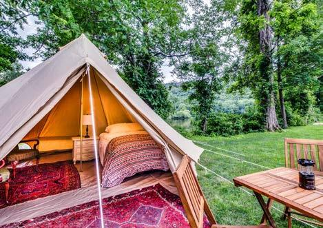 The tent also includes side tables, a lamp, alarm clock, coffee maker, and accompanying items, a lantern, a fan, a heater, and a table. Is everyone camping in the same area?