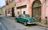 Cuba (Capital: Havana) Cuba is an island located 90 miles south of Florida.