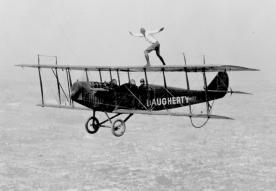 Most of the first pilots made their living by barnstorming. Barnstorming is another word for performing aerial stunts and parachute jumping.