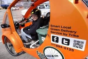 ZOOM Yvonne LeFave in her ELF eco-friendly delivery vehicle in Lansing Tuesday 4/24/2014 for her Go Green Trikes business.