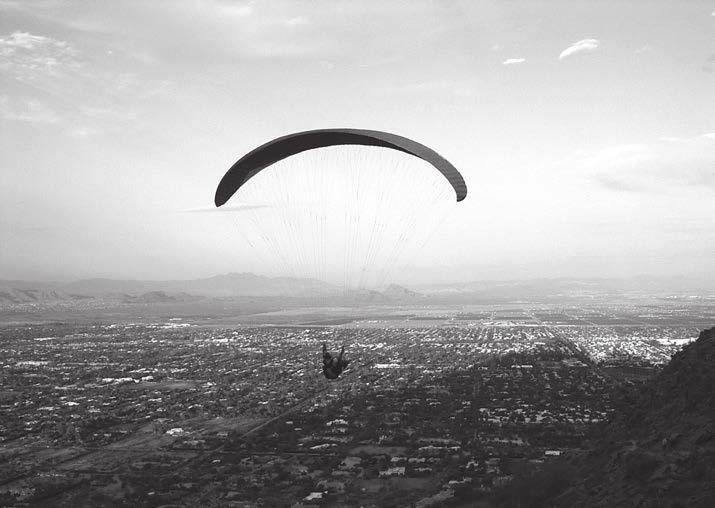24 60 hikes within 60 miles: Phoenix A parachuter takes off on a sunset ride from the Cholla Trail on Camelback Mountain. and you ll see the McDowell Mountains to the northeast.