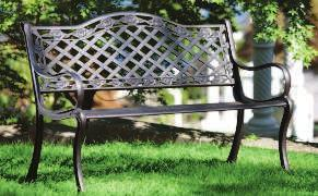 CAST IRON BENCH A throwback to turn-of-the-century styles, this bench has all the charm and grace of