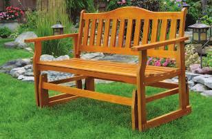 "75""H WOODEN GLIDER BENCH Drift away to a world all your own on this glider bench crafted of"