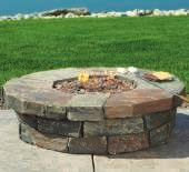 CLEARWATER GAS FIRE TABLE A 20-lb., 50,000 BTU propane tank and stainless steel burner power this unique faux stone fire pit.