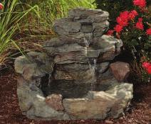 4-TIER ROCK FOUNTAIN Features a sprawling faux rock design with a