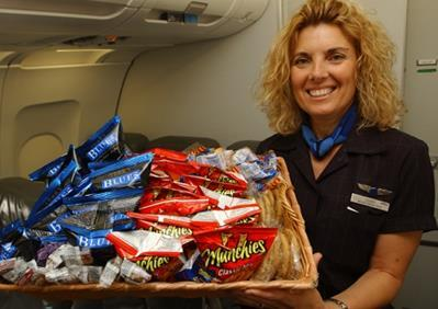 During the flight, the flight attendants will come around with drinks, and