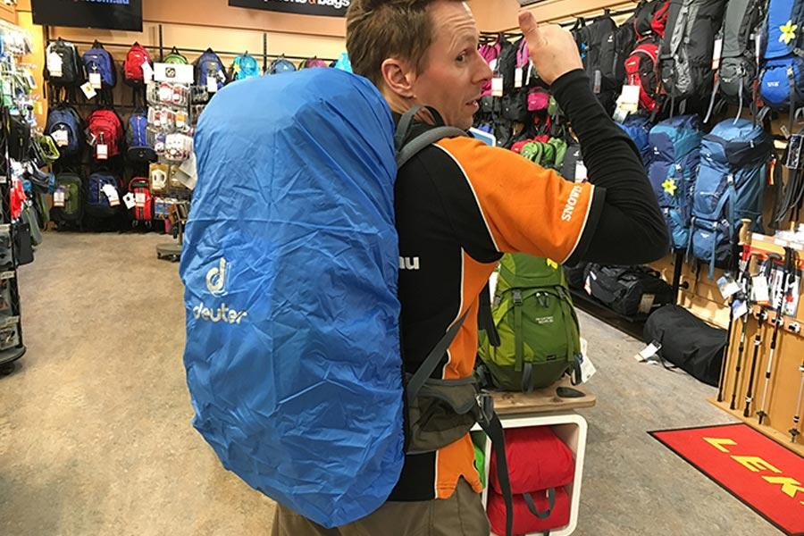 Yep, that ll keep it dry says Kym. Most hiking and travel backpacks come with a built-in rain cover that tucks away neatly into the base of the bag. 2.