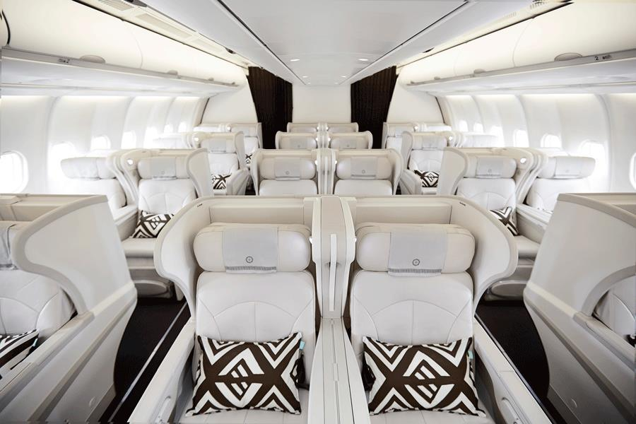 Features of Business Class on flights to Fiji: Angled lie-flat beds with (8 degrees inclined from horizontal) with customised controls 76 of bed length, and an integrated privacy divider between