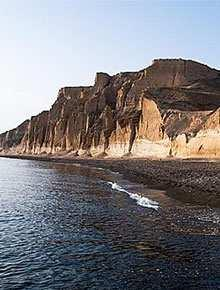 Santorini Beaches on the South Coast: Santorini Beaches on the South West Coast: Vlichada Beach Vlichada combines a dark sanded beach with a marina for mooring private yachts.