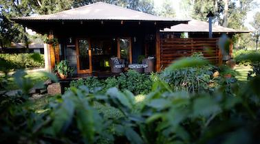 Arusha Coffee Lodge The lodge, set in picturesque gardens, is surrounded by some of Africa s most beautiful landscapes and holds central place at the foot of Mount Meru.