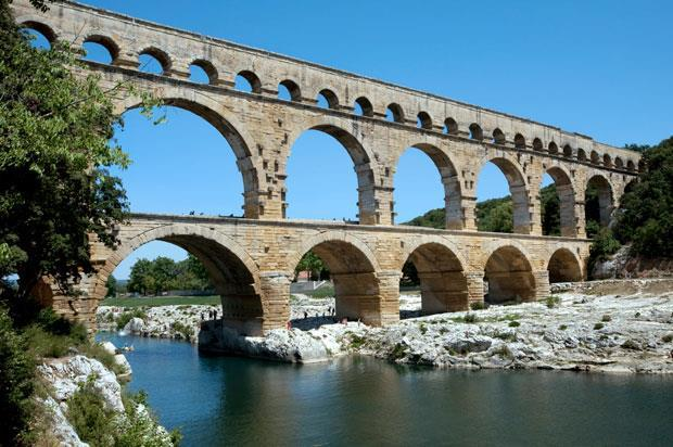 An aqueduct is a system of bridges and canals used to carry