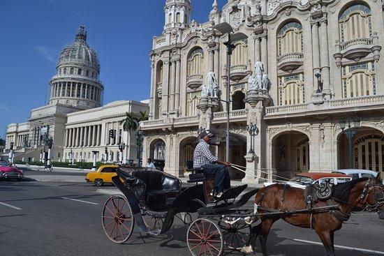 After lunch enjoy a scenic drive that will take you around the National Capitol (monumental work of the Twentieth Century and former home of the legislature in Cuba before