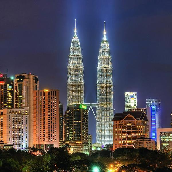 Kuala Lumpur The cultural hub of Malaysia, Kuala Lumpur is visually defined by the iconic Petronas Twin Towers, which, at 88 stories high, are the tallest twin buildings in the world and a vision of