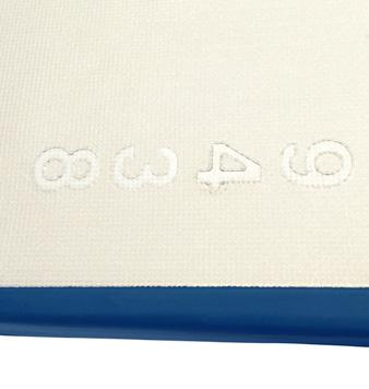 Dual layer support surface incorporating a full size memory foam overlay and durable high density foam base.