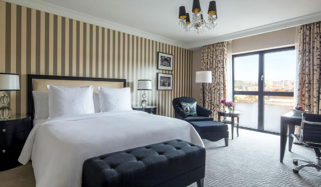 ECLECTIC ELEGANCE Unwind in lavish Four Seasons guest rooms among the largest in Prague.