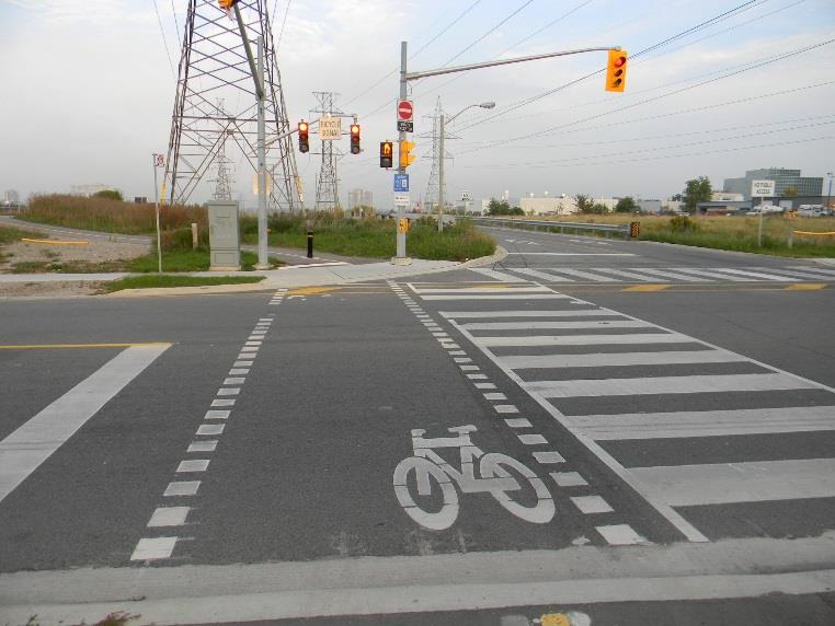 Roadway Crossings Example of Signalized Road Crossing at Alness Street on the Finch Hydro Corridor Trail Along the length of the trail there will be road crossings at existing
