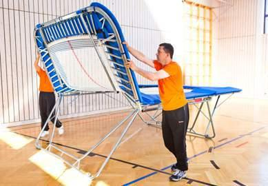 Figure 11 Should the trampoline have standard roller stands, take the weight of the trampoline at one end ensure that