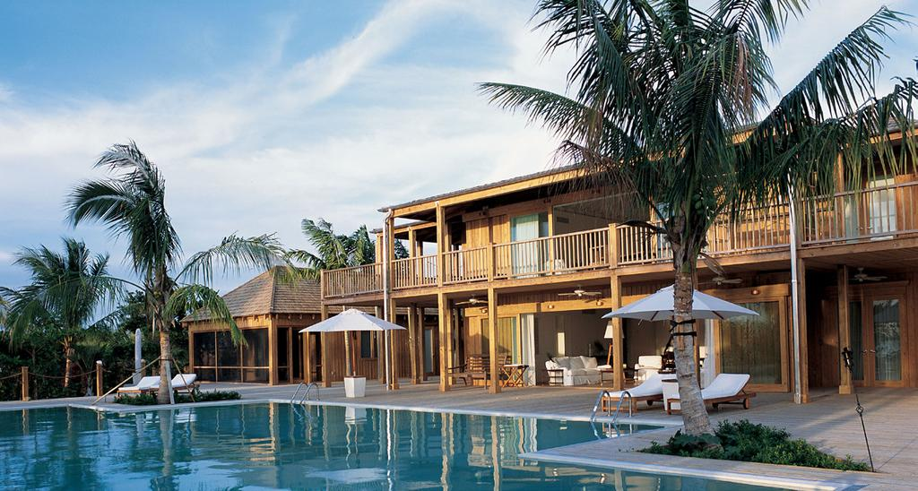 Love Pumpkin Accommodation COMO PARROT CAY ESTATE Love Pumpkin: Perched beside a large expanse of pristine white beach, Love Pumpkin is an oceanfront residence where lush gardens and coconut palms