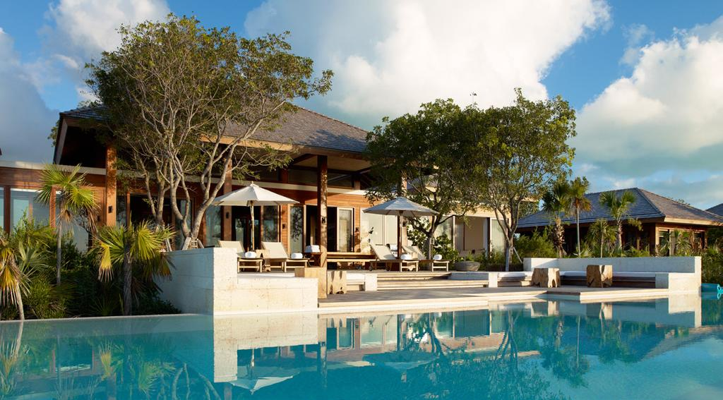 The Sanctuary Accommodation COMO PARROT CAY ESTATE The Sanctuary: The 8,947sq ft (831sq m) main house features two ocean-facing bedrooms on the first floor and a garden-facing bedroom on the ground