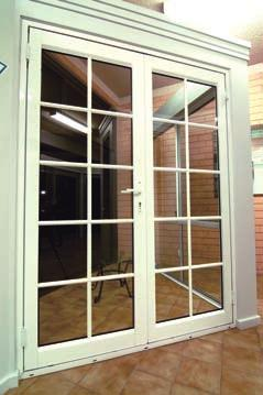 A pivot door rotates on two metal pivots at the top and bottom