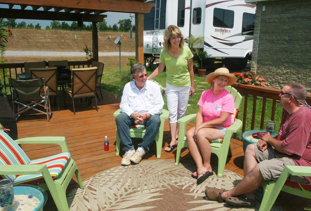Developers Larry and Sandy Harris, left, visit with Dena and Woody Wood on their deck, which extends from a covered pergola.