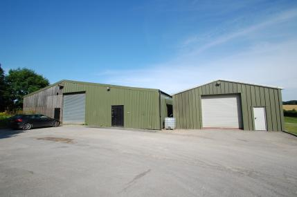 BUILDINGS Situated to the east of the house and north of the holiday cottages is a useful range of modern general purpose buildings situated on tarmac yard area.