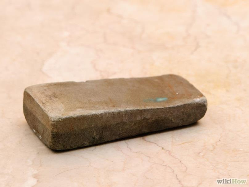2. Lubricate your sharpening stone. If you are using a whetstone or ceramic stone, you should soak the stone in the water for the correct amount of time.