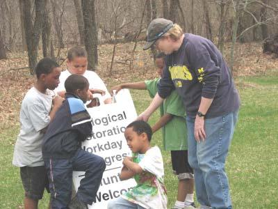 Earth Day with Inner City Outings By Barbara Powell Five children from Hikone Community Center in Ann Arbor celebrated Earth Day on April 19 with a Sierra Club Inner City Outing (ICO) service trip at