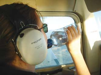 For short flights (under one to two hours) water will most likely be sufficient for preventing dehydration.