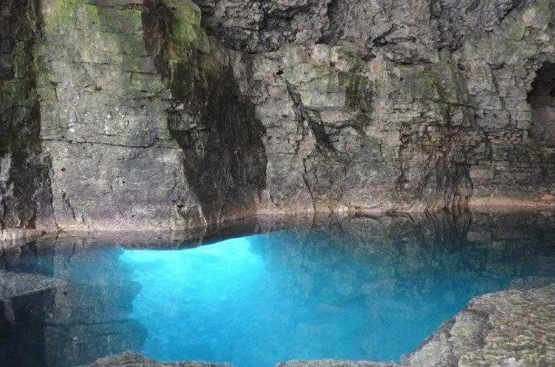 An underwater cave with sapphire blue water at Bruce Peninsula National Park.