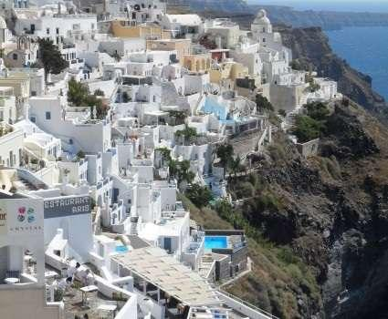 Santorini, Greece in 3 Days: Living like a Local Santorini's Fira Town nestled into volcanic cliffs overlooking the Aegean Sea Table of Contents By Megan Magee About the Author Day 1 1) Nea Kameni