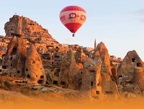 See hot air balloons float above the fabled fairy chimneys of unearthly Cappadocia, a UNESCO World Heritage site.
