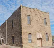 was built in 120 days in 1879 of native sandstone at a cost of $5,629. The first floor has a dining room, kitchen, stage area and restroom.
