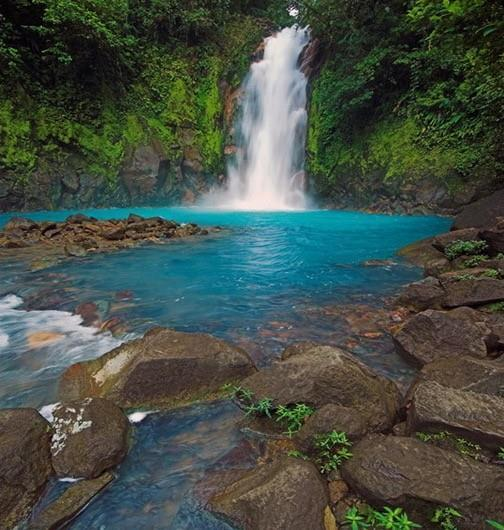 Blue River & Waterfall In the middle of the rainforest lies one of