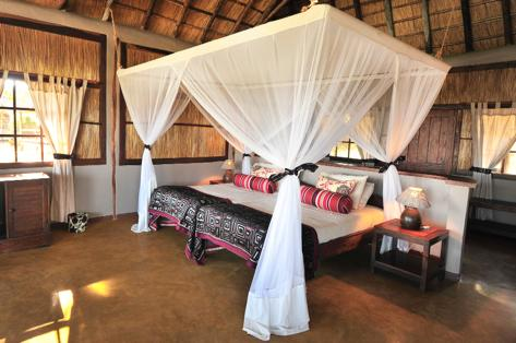 Our eight private safari chalets have been built on raised wooden platforms and have thatched roofs. They are tastefully decorated with African style and charm.