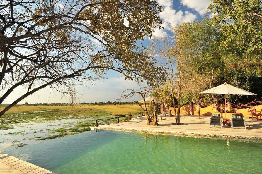 Infinity Pool & Natural Hot Tub Next to the bar is our infinity pool and the only natural hot spring in the Luangwa Valley.