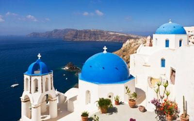 Today, transfer to port and aboard ferry to Santorini. The lively colors of the white Cycladic houses and blue painted windows contrast stunningly the black volcanic rock rising from the sea.